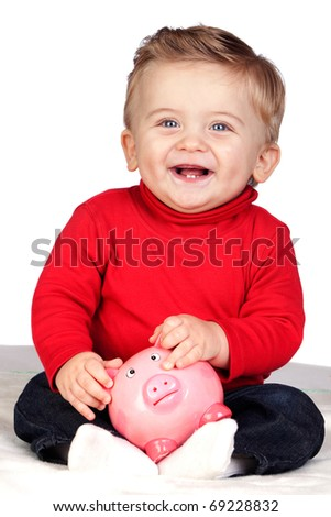 Beautiful blond baby with a piggy-bank isolated on white background