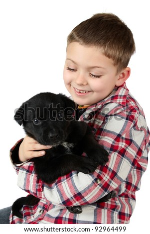 Beautiful blond boy with a black puppy