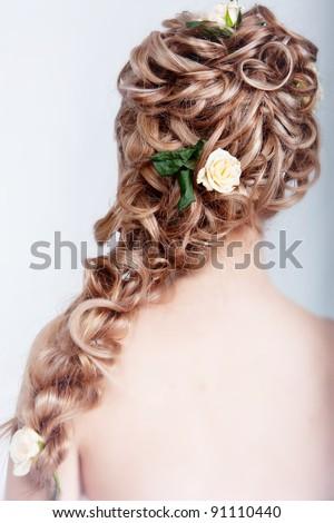 Beautiful blond bride hairstyle photo in studio