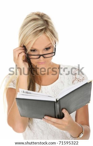 Beautiful blond business woman checking her diary
