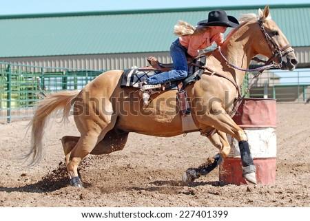 Barrel Race editorial photo. Image of woman, western