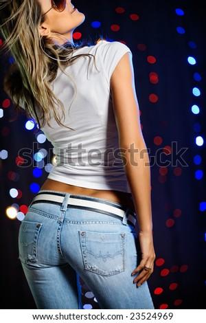 Beautiful blond female dancing - stock photo