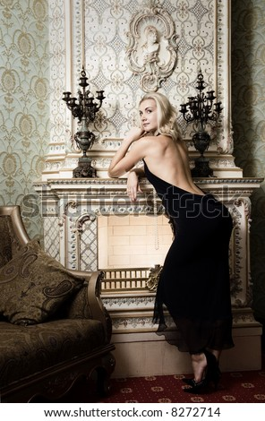 Beautiful blond girl near the fireplace