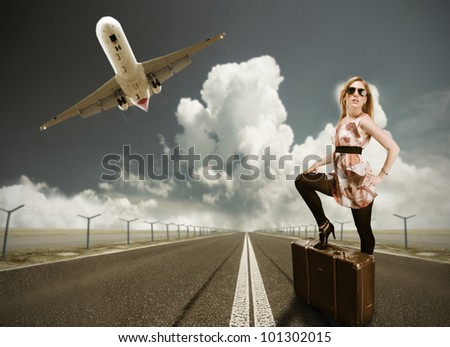 Beautiful blond girl posing on runway, concept of travel. In retro design
