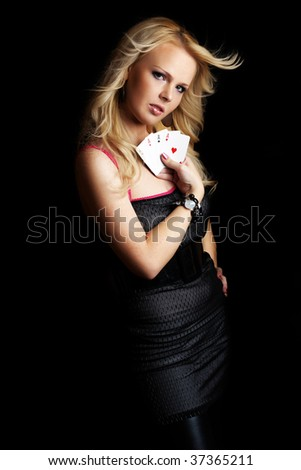 Beautiful blond girl showing her poker cards