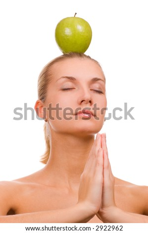 Beautiful blond girl with a green apple on her head