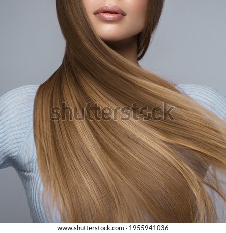 Beautiful blond girl with a perfectly smooth hair, and classic make-up. Beauty face and hair. Stockfoto ©