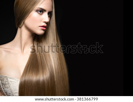 Beautiful blond girl with a perfectly smooth hair and classic make-up. Beauty face. Picture taken in the studio on a white background.