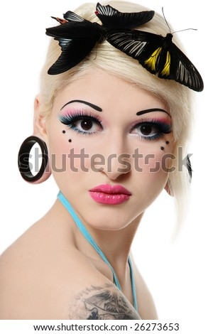 Beautiful blond girl with bright makeup and tropical butterflies on her head