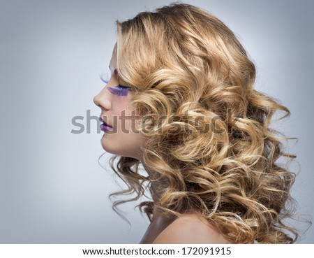 Beautiful blond girl with fluffy hair
