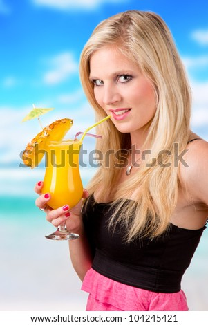 Beautiful blond girl with summer drink