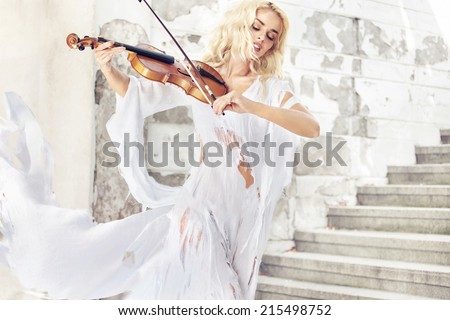 Stock Photo Beautiful blond hair woman with violin