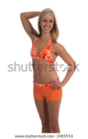 Beautiful blond in an orange floral pattern bikini top and contrasting boy short bottom with her right hand on her head and her left on the hip