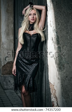 beautiful blond in black dress - stock photo