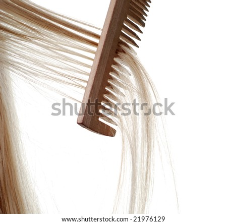 beautiful blond long hair and wood comb