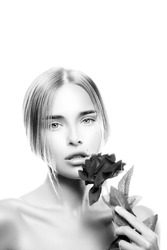 beautiful blond model girl with rose flower, isolated on white background. Monochrome