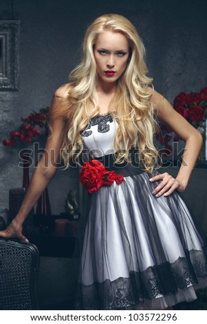 Beautiful blond model posing - stock photo
