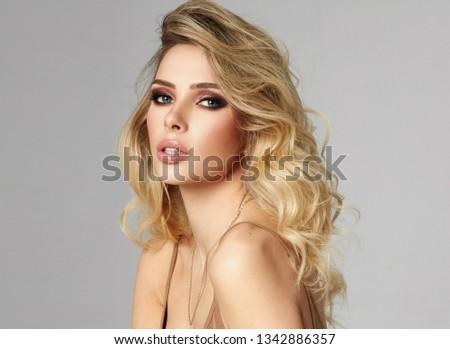 Beautiful blond seductive woman looking at camera #1342886357