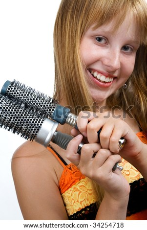 Beautiful blond teen girl with hair brushes