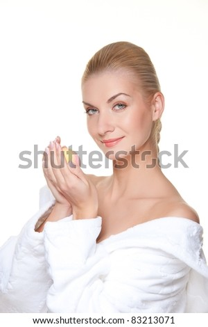 Beautiful blond woman holding a soap.