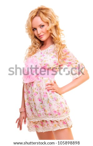 Beautiful blond woman in a pink dress high-key portrait. isolated on a white background - stock photo