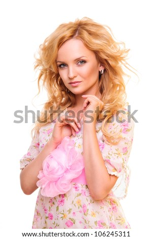 Beautiful blond woman in a pink dress high-key portrait. isolated on a white background