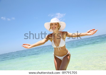 Beautiful blond woman in bikini by blue lagoon