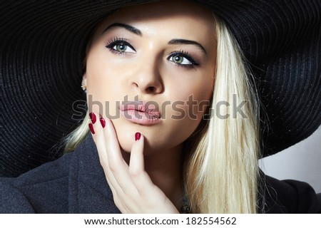 Beautiful Blond Woman in Black Hat. Fashionable Lady. Elegance Beauty Girl. Manicure