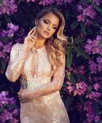 beautiful blond woman in elegant sequin dress