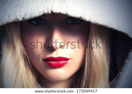 Beautiful Blond Woman in Hood. With Red Lips. Box. Close-up Beauty Girl