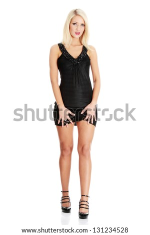 Beautiful blond woman in sexy elegant black dress, isolated on white background