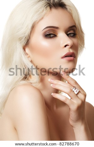 Beautiful blond woman model with brown smoky-eye make-up and white ring