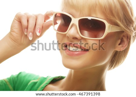 6688fe943 beautiful blond woman wearing sunglasses over a white background #467391398