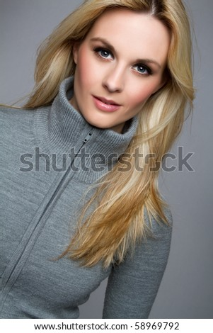 Beautiful blond woman wearing sweater