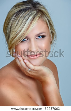 stock photo : beautiful blond woman with blue eyes and smoky make-up on eyes