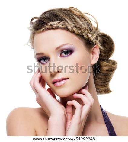 Beautiful blond woman with fashion hairstyle with element of pigtail- on a white
