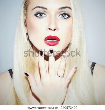 Beautiful blond Woman with Manicure.Sexy Beauty Girl.Make-up