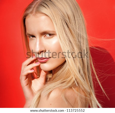 beautiful blond women pink lips looking on red background