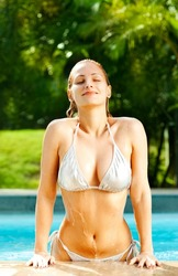 Beautiful blonde coming out of the swimming pool