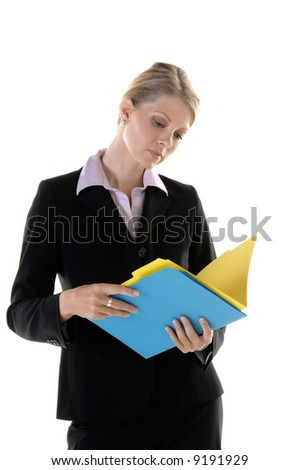 Beautiful blonde Executive reviewing a file in the office