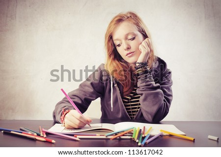Beautiful blonde girl doing her homework