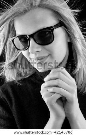 http://image.shutterstock.com/display_pic_with_logo/381634/381634,1259872985,3/stock-photo-beautiful-blonde-girl-in-a-black-turtleneck-with-retro-sunglasses-on-black-background-black-and-42145786.jpg