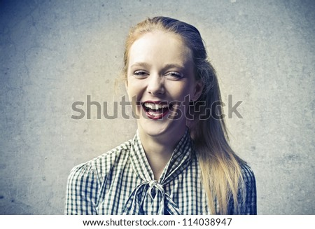 Beautiful blonde girl laughing