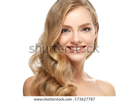 Beautiful Blonde Girl Portrait with healthy Hair.Clear Fresh Skin.Smiling Girl Isolated on a White Background.Skincare.Spa.Beauty Model