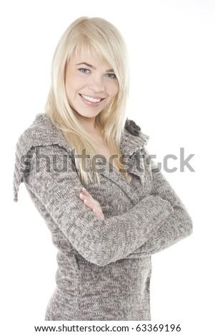 Beautiful blonde girl posing in warm sweater - stock photo