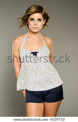 beautiful blonde girl posing on grey background