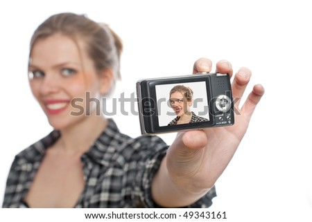 beautiful blonde girl taking a photo of herself with a digital camera