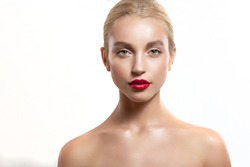 Beautiful blonde girl with professional makeup and red lipstick. Her hair was in a bun. insulation on white background