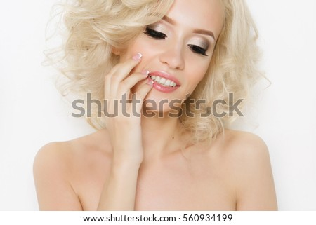 Beautiful blonde girl with stacking, permanent eyebrows and lips, professional makeup #560934199