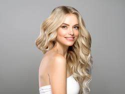 Beautiful blonde hair woman long curly hairstyle healthy skin natural makeup